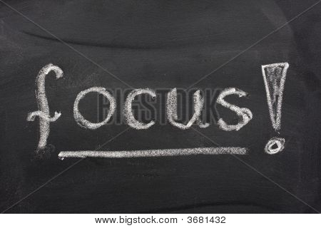 Word Focus On A Blackboard