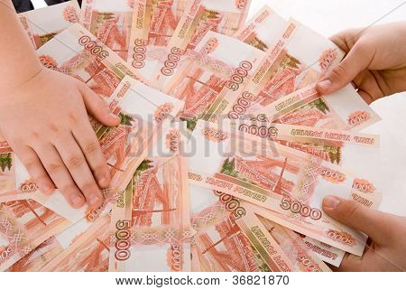 The Hands Holding  Russian Banknotes