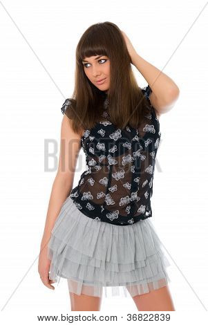 Portrait Of A Stunning Young Woman Posing In Short Skirt And Blouse