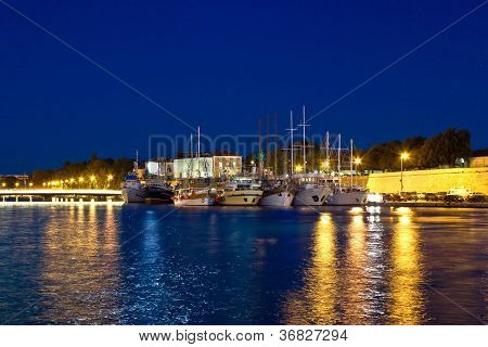 Fishing Boats In Safe Harbor On Evening