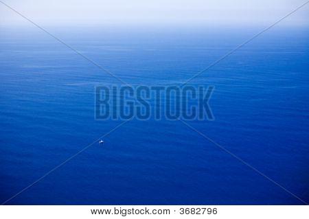 Small Boat In Great Ocean