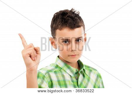 Studio Portrait Of A Schoolboy Making Warning Sign