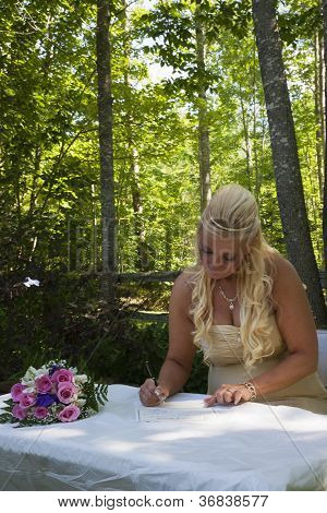 Bride Signs Wedding License