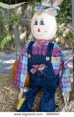 Strawdoll On Hay With Pumpkin