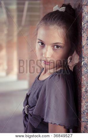 Teenage Girl Near Marble Columns