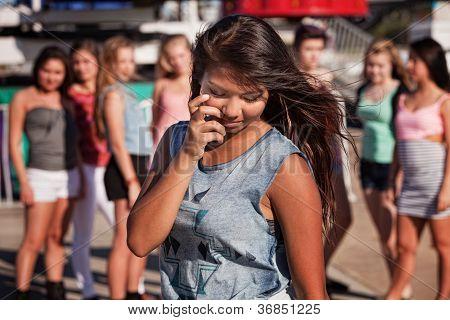 Shy Teenage Girl Looking Down