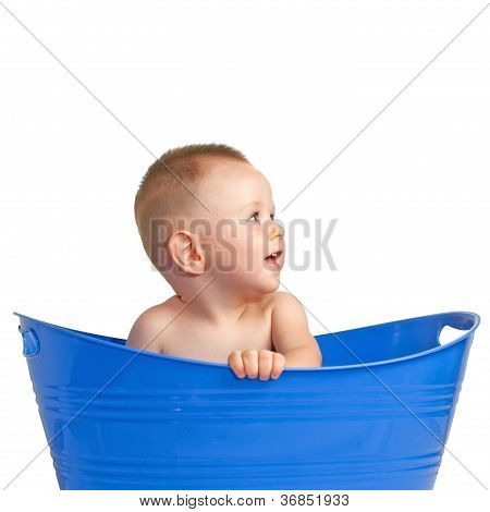 Happy Baby Playing In A Plastic Basket
