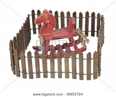 Rocking Horse Enclosed In Picket Fence