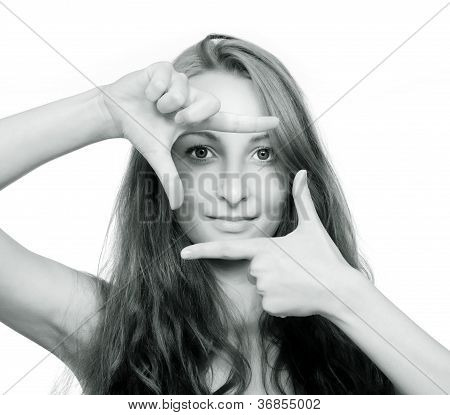 Girl Looking Through A Finger Frame