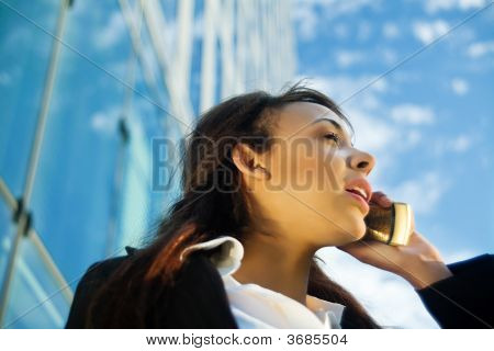 Using Phone In Front Of Office