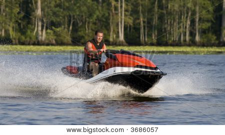 Man Riding Wave Runner In River