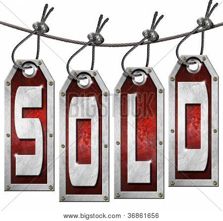 Sold Tags Hanging On White Background