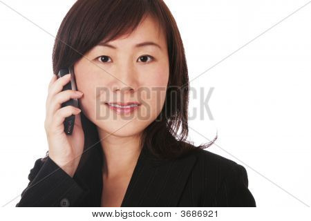 Asian Businesswoman With Mobile Phone