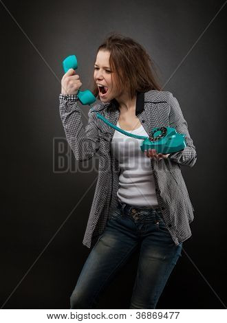 Portrait Of The Teen Girl With Old Phone