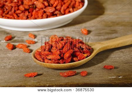 Dried Goji Berries In Wooden Spoon