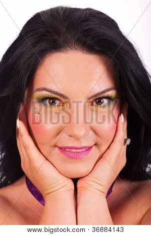 Beauty Woman Holding Face In Hands