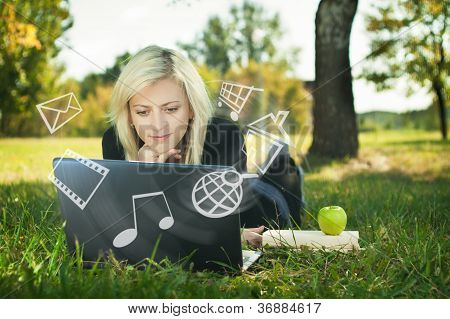 Girl In Park With Laptop Multimedia Concept