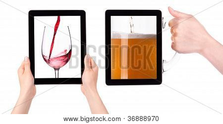 Hands Holding Digital Tablet With Red Wine And Beer