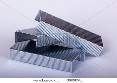 Three Sets Of Staples On White Background