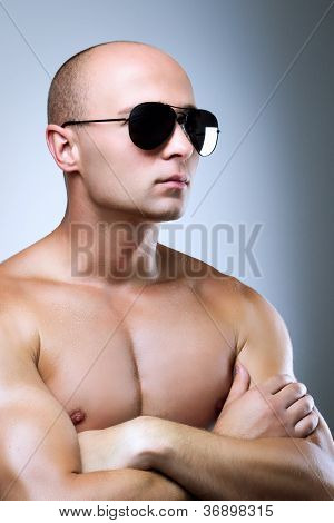 Muscular man with glasses and naked chest