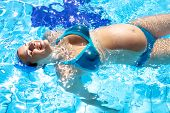Happy Pregnant Woman Swwing In Swimmingpool