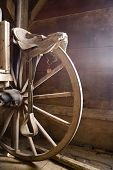stock photo of wagon wheel  - Fragment of a wheel of antique horse - JPG