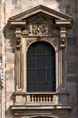 stock photo of castello brown  - a window in the front of the dome of milan - JPG
