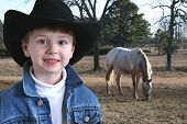 Adorable Four Year Old Cowboy poster