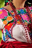 Folkloric Mexican dress detail from Puebla, Mexico