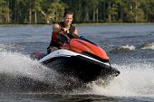 pic of jet-ski  - Man riding wave runner in river enjoying a nice summer day - JPG