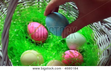 Placing An Easter Egg In The Basket