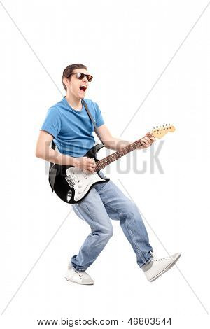 Full length portrait of a guy playing on an electric guitar isolated on white background