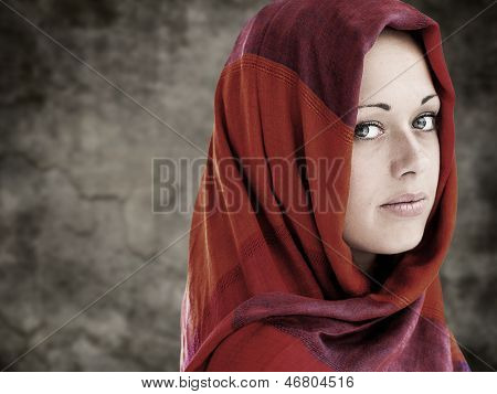 Young Arabic woman in wearing islamic scarf
