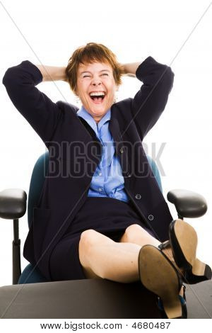 Businesswoman At Desk - Laughing