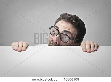 man with glasses who has a lot of fear