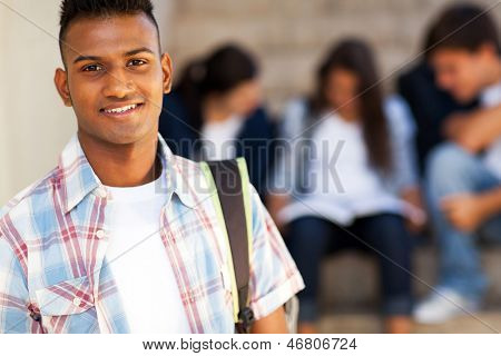 handsome indian teenage high school student carrying schoolbag