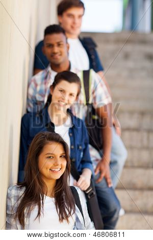 group of highschool girls and boys standing by corridor