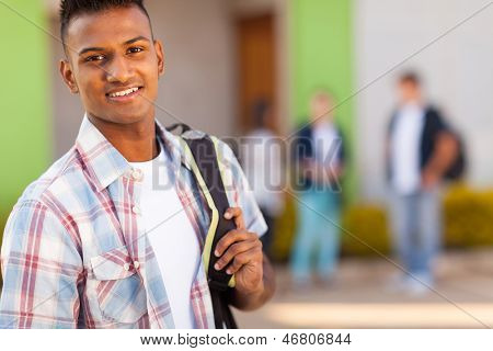 portrait of male indian high school student with schoolbag