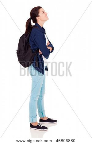 side view of female high school student looking up on white background