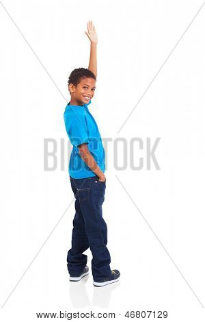 happy little indian boy waving goodbye on white background
