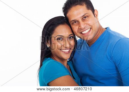 portrait of young indian couple over white background