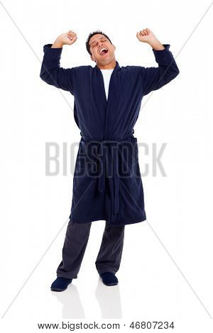 sleepy indian man yawning and stretching after waking up isolated on white
