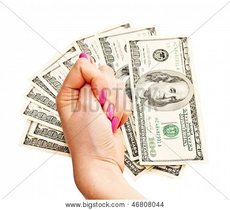 Woman's Hand Shows Fig On Money Background, Isolated On White