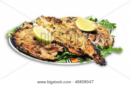 Grilled Fish With Greens On The Plate - Isolated On White Background