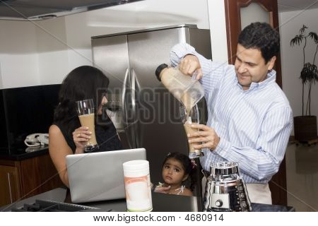 Beautiful Family Cooking In Kitchen With Appliances