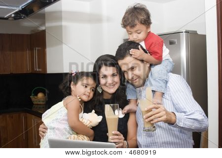 Beautiful Family Cooking In Kitchen