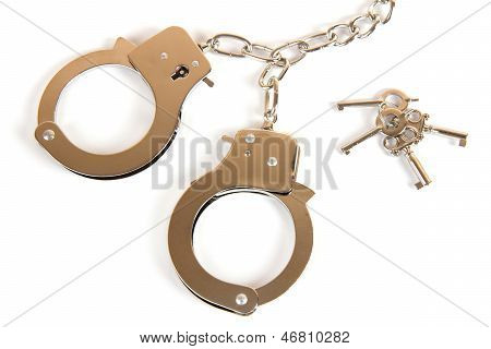 A Pair Of Handcuffs With Keys