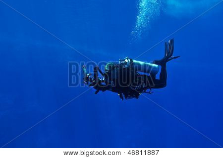Diver taking underwater photo