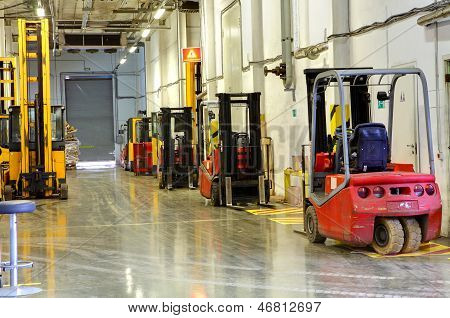 Forklift Trucks In Stock. Corridor Large Warehouse.