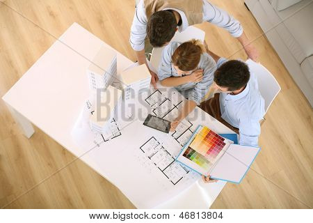 Upper view of architects working in office